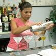 Linda K practices making drinks